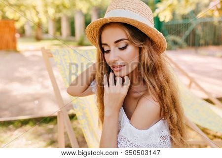 Lovely Lady With Curly Golden Hair And Nude Make-up Posing Outdoor Enjoying Good Sunny Weather. Clos