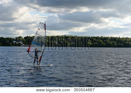 Moscow Region, Russia - July 6, 2019:windsurfing On The Klyazma Reservoir In The Moscow Region