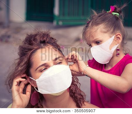 Family wearing facial disposable mask to avoid viral infection. Coronavirus protection