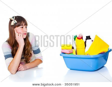 Teenage girl looking at basin with chemical detergents