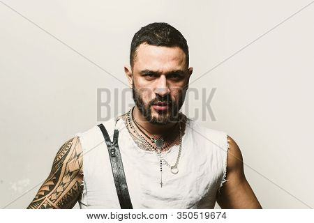 Close Up Portrait Of Handsome Guy . Close Up Face Of Fashionable Latin Man On Grey Background