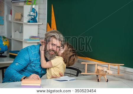 Elementary School Tutorship. Afterschool Tutoring. Happy School Kids At Lesson. Teachers Day. Pupil