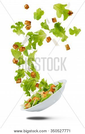 Lite Salad Flying On White, Ingredients Of Caesar Salad