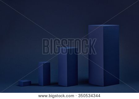 Abstract composition with geometric figures.  Set of rectangular parallelepipedes on a blue   background. Abstract  background with copy space for design of advertising, engineering draft, web design.
