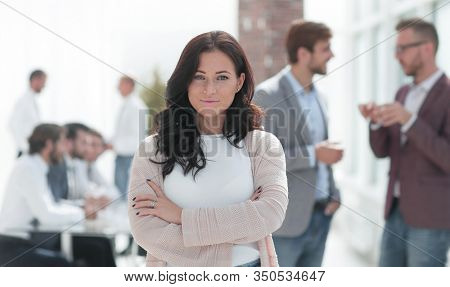 Executive young woman standing in modern office.