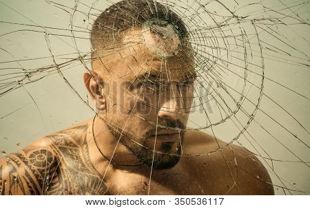 Overcoming The Obstacle. Determined Man Knocking Down A Glass Wall With A Head, Obstacle Concept. St