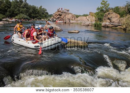 Chiang Mai, Thailand - February 12 2019: Young Person Rafting On The River, Extreme And Fun Sport At
