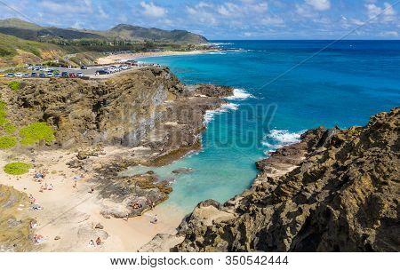 Tourists Swim In Halona Beach Cove Near The Blowhole In Oahu, Hawaii