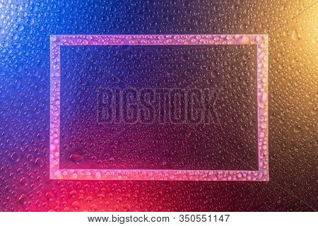 Drops Of Water Repellent Surface In Neon Light, Frame Trend 2020 Color Aqua Menthe Classic Blue Lush