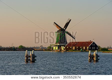Windmill At Suset