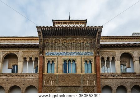 SEVILLE, SPAIN - December 09 2019: Exterior facade of the Patio de la Monteria courtyard in the Real Alcazar, Seville, Spain a Unesco listed World Heritage Site