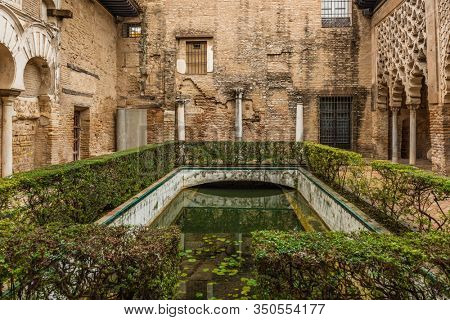 SEVILLE, SPAIN - December 09 2019: Patio del Yeso courtyard in Real Alcazar, Seville, Spain with remnants of Almohad Moorish architecture