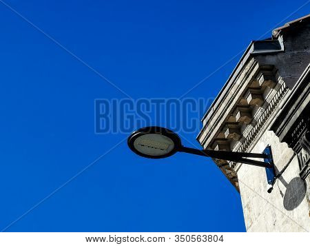 Partial View Of An Ancient Typical Building And Fixed Modern Street Light With Powerful Led Bulb Lig