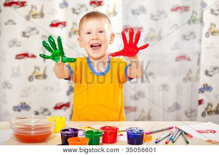 boy with painted fingers