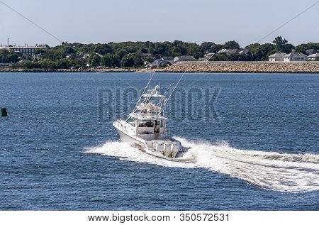 New Bedford, Massachusetts, Usa - August 12, 2019: Three Large Outboards Pushing Powerboat Anna Stro