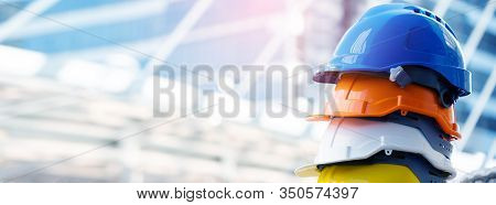 Safety Construction Worker Hats Blue, White, Yellow, Orange. Teamwork Of Construction Team Must Have