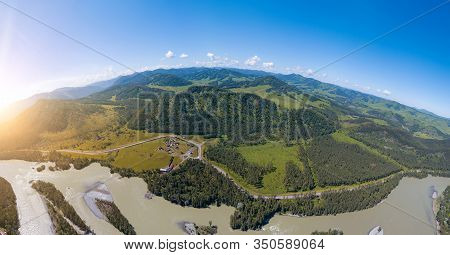 Aerial View Of Planet Earth With Nature And Picturesque Landscape Near A Mountain Along River And Gr