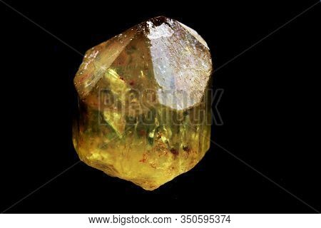Citrine Mineral Isolated On The Black Background