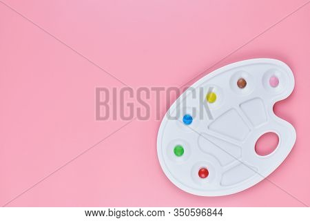 Art Of Sweetmeats Concept, Copy Space. Sweet Candy In Paint Palette On Pink Background. Love To Colo