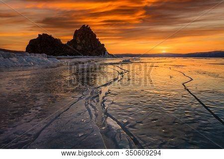 Shaman Rock Or Cape Burhan On Olkhon In The Winter. Lake Baikal, Siberia, Russia