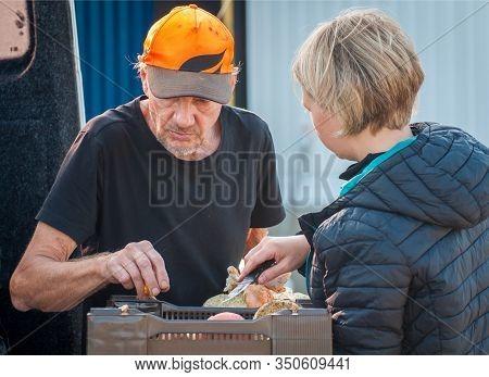 Kontiomaki, Finland - August 29, 2018. Inexperienced Mushroom Pickers Brought Mushrooms To The Plant