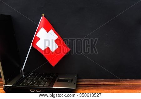 Lag Of Switzerland , Computer, Laptop On Table And Dark Background