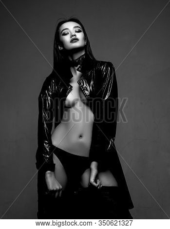 Young And Free. Woman In Black Latex Leather Coat. Desire. Makeup And Hair Style. Sensual Woman. Bea