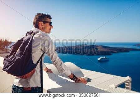 Santorini Traveler Man Enjoying Caldera View From Fira Or Thera, Greece. Tourism, Traveling, Vacatio