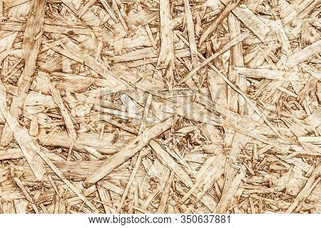 Brown Chip Board Background. Wooden Osb Plywood Pattern Texture.