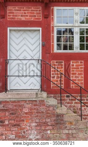White Door In A Red Half Timbered House In Haderslev, Denmark