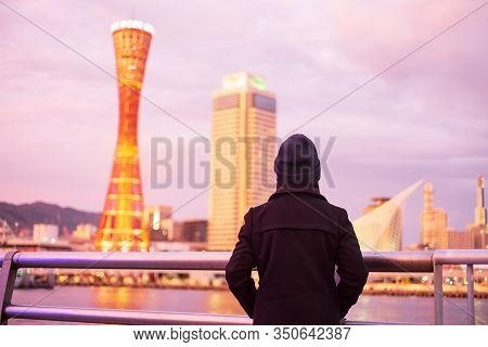 Young Woman Traveling At Kobe Port Near Osaka, Happy Asian Traveler Looking Beautiful Modern Buildin