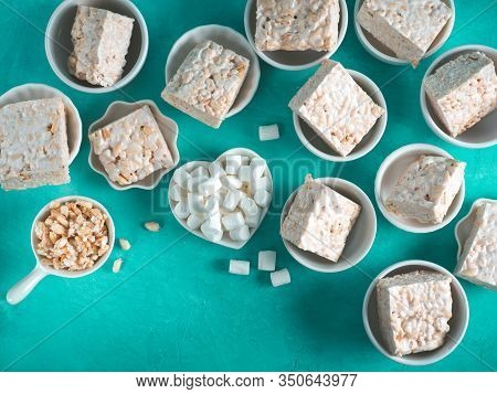 Homemade Square Bars Of Marshmallow And Crispy Rice And Ingredients On Azure Blue Background. Americ