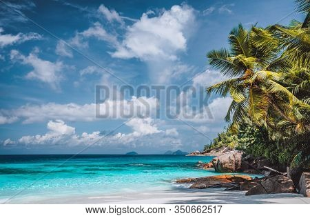 Perfect Tropical Tranquil Beach. Pristine Crystal Clear Ocean Water With Blue Sky And White Clouds.
