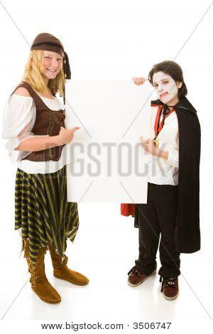 Halloween Kids Holding Sign