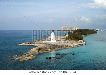 The Narrow Tip Of Paradise Island With A Lighthouse Standing Between Caribbean Sea And Nassau Harbou