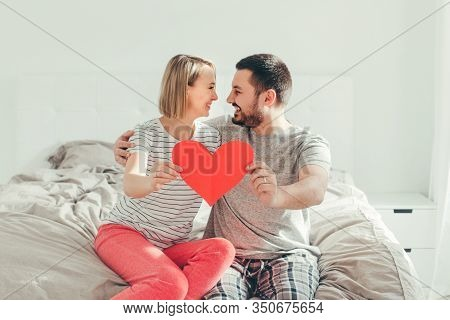 Happy Strong Marriage. Happy Funny Couple In Love Holding Red Paper Heart. Heterosexual Family Man A
