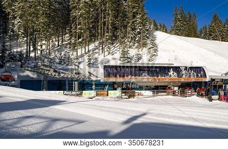 Demanovska Dolina, Slovakia - February 8: Ski-lift Chair And Skiers In Ski Resort Jasna In Low Tatra
