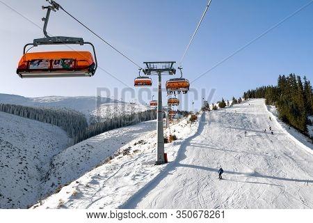 Demanovska Dolina, Slovakia - February 8: Skiers On Slope From Ski Lift Chair In Resort Jasna On Feb