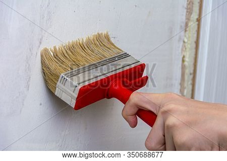 Interior Decoration Of A House Or Room. Primer The Walls With A Primer Or Paint. Repair And Priming