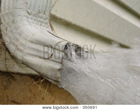 House Gutter Downspout Gushing Water