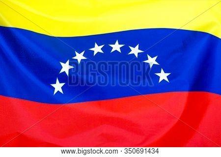 Fabric Texture Flag Of Venezuela. Flag Of Venezuela Waving In The Wind. Venezuela Flag Is Depicted O