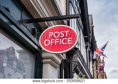 Windsor, Uk- Feb 10, 2020: Post Office Sign Outside A Post Office In Windsor