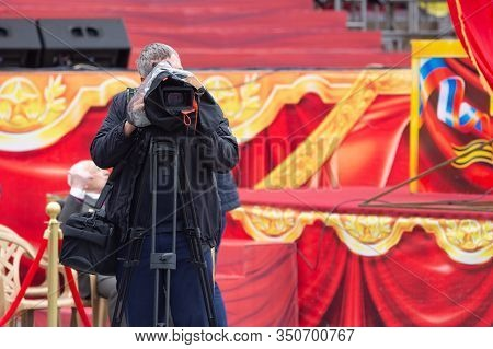 Anapa, Russia - May 9, 2019: A Television Operator With A Camera On A Tripod Works At The Victory Da