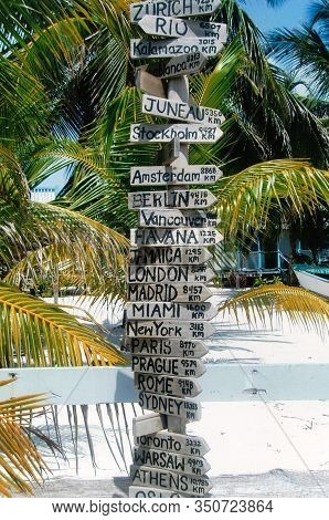 Tall Signage, Showing In What Direction And How Many Kilometers Away A City Is, Located In Caye Caul