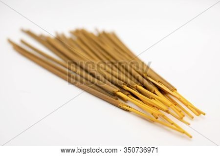 Brown Indian Incense Aroma Sticks Isolated On White Background Close Up. Set Of Buddhist Incense Sti
