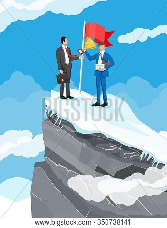 Two Businessmans Standing On Top Of Mountain With Flag And Trophy. Symbol Of Victory, Successful Mis