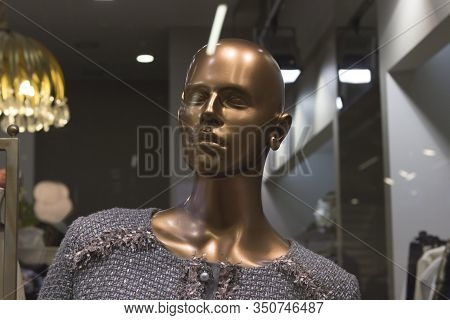 Bald Bronze Shiny Sparkling Metallic Female Hairless Mannequin In A Business Suit, Stylish Formal Dr