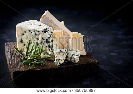 Cheese On Wooden Boards. Camembert And Dorblu On Wooden Background. Dairy Products