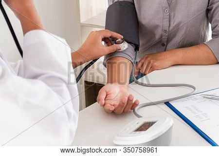 The Doctor Measured Blood Pressure, The Patient Examined The Heartbeat And Talked About Health Care