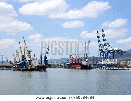 Novorossiysk, Russia - August 01, 2019: Berths Of The Novorossiysk Port Equipped With Port Cranes
